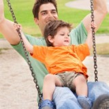 Father and son on swing